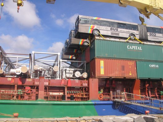 Cargo Ship Hauling Busses