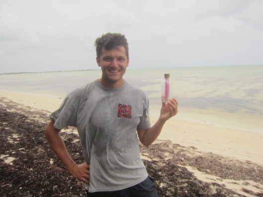 Me with Clinton and Gwen's Bottle on the Beach