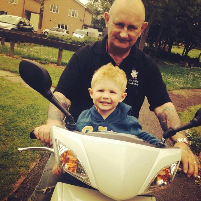 Clinton with Boy on Bike