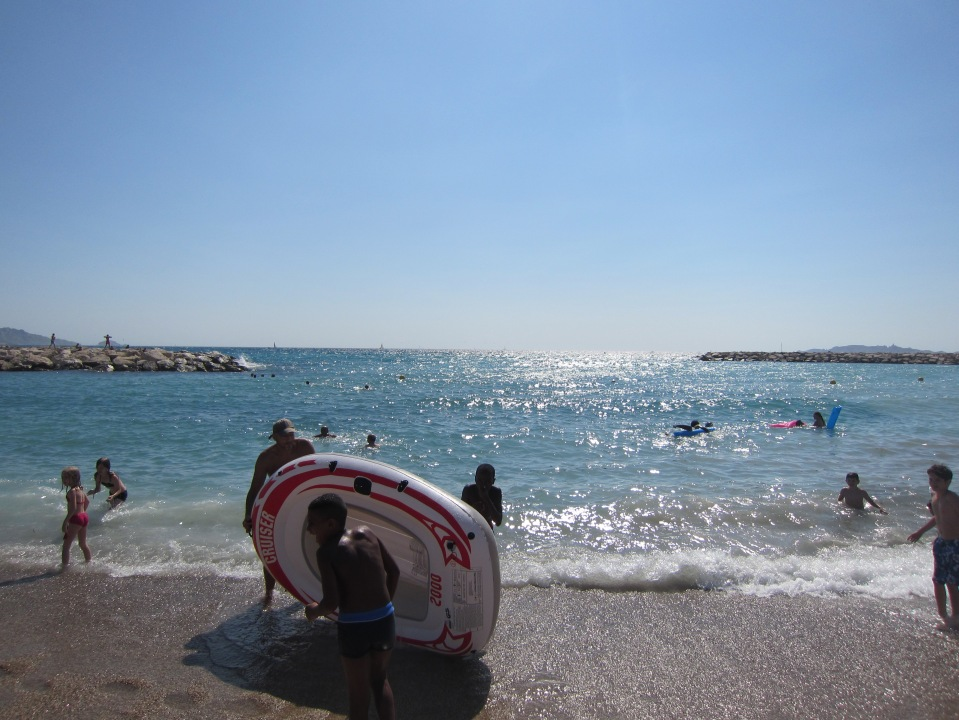 Marseille Kids with Raft on Beach
