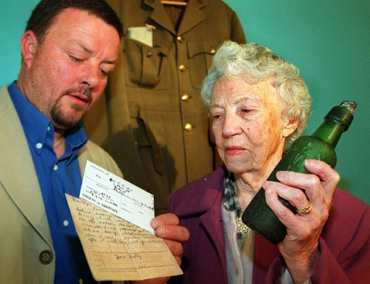 Gowan and Emily Crowhurst with Private Hughes message in a bottle